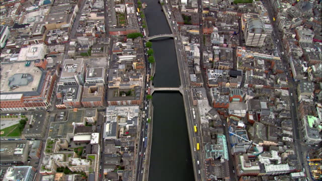 overhead wide shot pan dublin cityscape, river liffey, and bridges/ ireland - hd format stock-videos und b-roll-filmmaterial