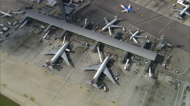 overhead wide shot zoom out terminal at heathrow airport / london, england - heathrow airport stock videos and b-roll footage