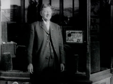 overland automobile salesroom, exterior, car and salesmen. overland automobile salesroom on january 01, 1916 in palo alto, california - salesman stock videos & royalty-free footage
