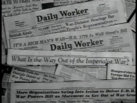 overlapping editions of british communist newspaper 'daily worker' exposing headlines dramatization male in suit reading 'daily worker' sot... - communism stock videos & royalty-free footage