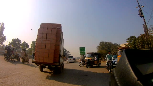 overloaded car in karachi - sindh pakistan stock videos and b-roll footage