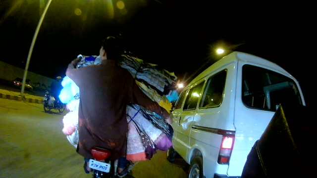 overloaded motorbike in karachi - sindh pakistan stock videos and b-roll footage