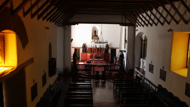 overlook of the hall of the jesuit church in calera de tango chile the altar with statues appears in the light in the background with the benches in... - jesuit stock videos and b-roll footage