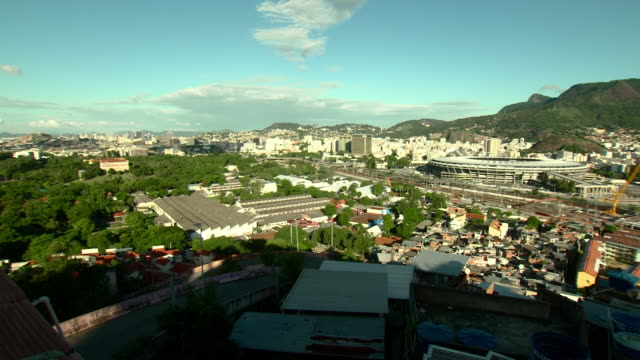overlooking city, estadio do maracana football stadium near high-rise buildings, low-rise favela, impoverished neighborhood, buildings in shadows fg,... - contrasts stock videos & royalty-free footage