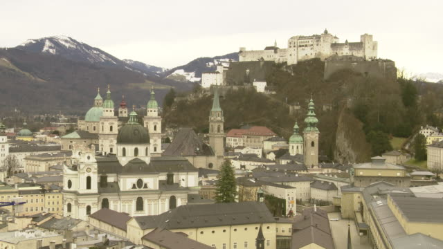 overlooking historic old town, city low-rise buildings, salzburg cathedral , franciscan church, saint peter's monastery, hohensalzburg fortress on... - peter snow stock videos & royalty-free footage