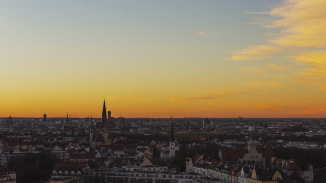 """T/L PAN & ZOOM overlooking Munich's cityscape during a very colourful sunset. First zooming out and then paning to the iconic television tower in """"Olympiapark"""""""