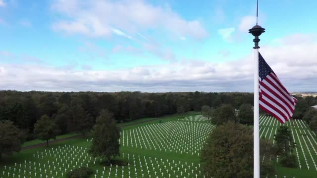 overlooking omaha beach the 70 hectare collevillesurmer military cemetery houses the graves of 9387 american soldiers who died in action during the... - omaha beach stock videos and b-roll footage