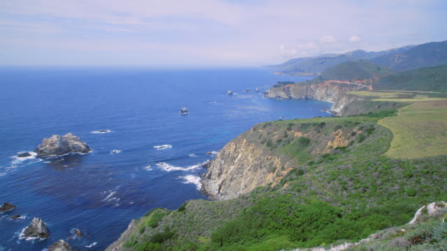 overlooking the rocky big sur coast with bixby bridge and highway 1 at right - bixby creek bridge stock videos & royalty-free footage