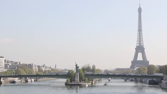 overlooking the seine with the eiffel tower - replica eiffel tower stock videos & royalty-free footage