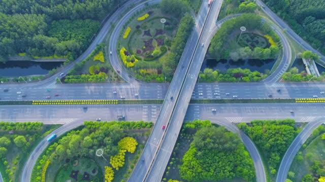 overpass aerial view - straßenüberführung stock-videos und b-roll-filmmaterial