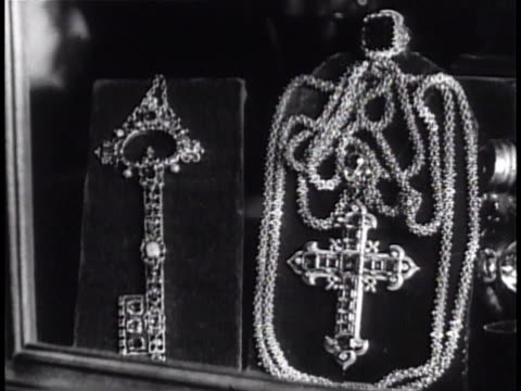 oversized ornate key cross jewelry cu male fingers holding ring of the fisherman placing into box - jewelry box stock videos and b-roll footage