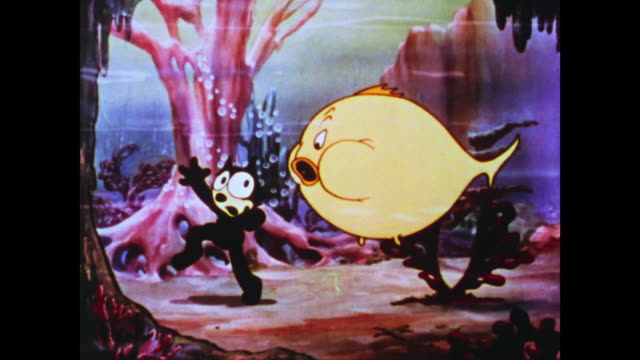 stockvideo's en b-roll-footage met overstuff fish in ocean approaches felix the cat and burps in his face - angst