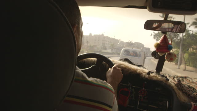 over-the-shoulder shot of a taxi driver in cairo, egypt. - dekoration stock-videos und b-roll-filmmaterial