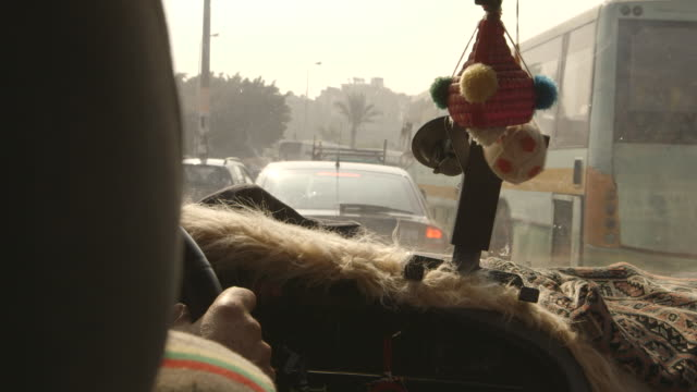 over-the-shoulder shot of a taxi driver navigating busy cairo traffic, egypt. - dashboard stock videos & royalty-free footage