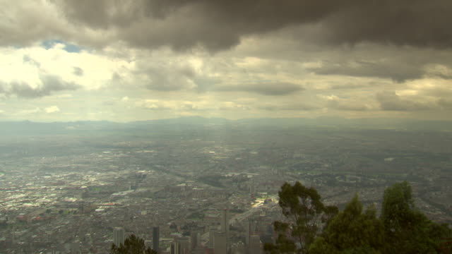 Overview of Bogotá, Colombia from surrounding hilltop on a cloudy, windy day.