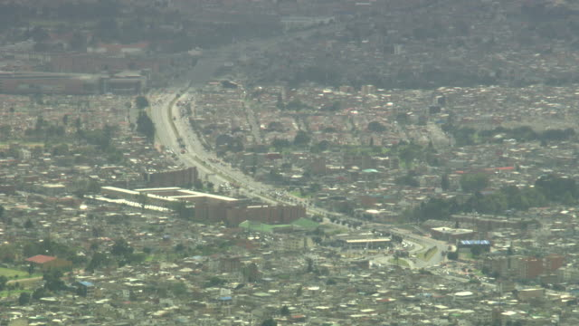 Overview of busy multi-lane road with roundabout, Bogotá, Colombia