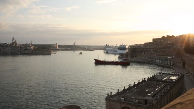 overview of port area at sunrise, valletta - cruise ship stock videos & royalty-free footage