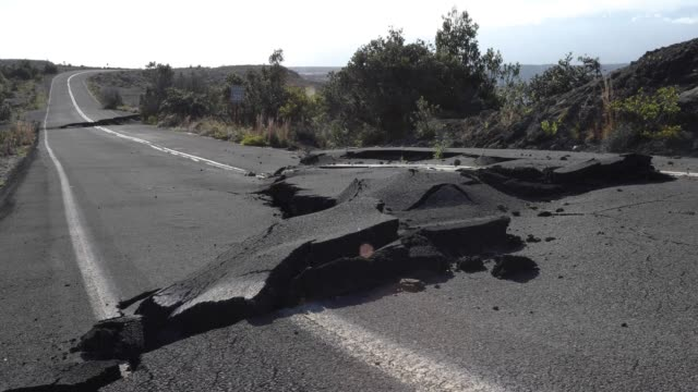 overview of road recently ruptured by earthquake - damaged stock videos & royalty-free footage
