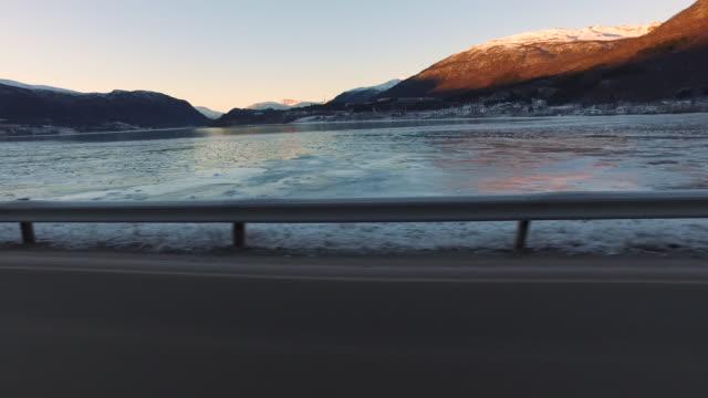 overview of the ramfjorden (ramfjord), norway - 車の視点点の映像素材/bロール