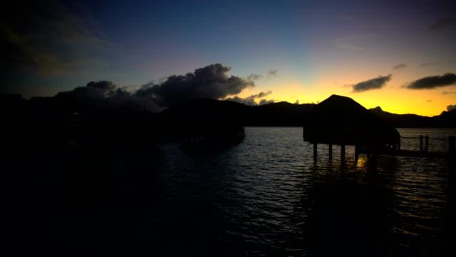 overwater bungalow at sunrise bora bora french polynesia - polynesian ethnicity stock videos & royalty-free footage