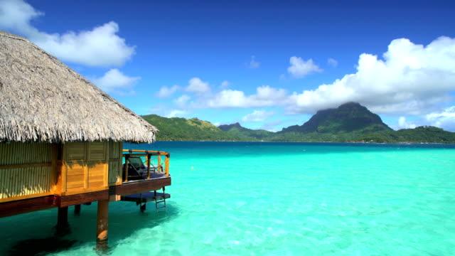 overwater bungalows mt otemanu aquamarine lagoon bora bora - polynesian ethnicity stock videos & royalty-free footage