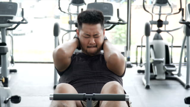 ms overweight asian man doing sit-ups, front view - sit ups stock videos & royalty-free footage
