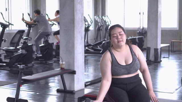 overweight girl lift little weight - addition key stock videos & royalty-free footage