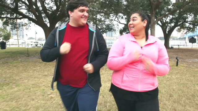 overweight hispanic couple having fun exercising - overweight active stock videos & royalty-free footage