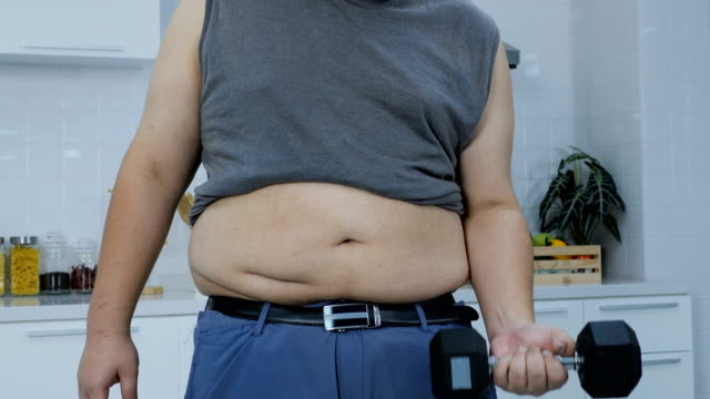 overweight man exercise for his health and getting in shape - - tights stock videos & royalty-free footage