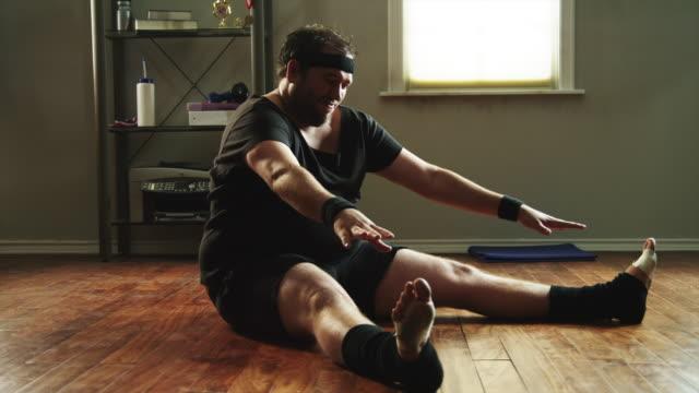 ws overweight man exercising / orem,utah,usa - orem stock-videos und b-roll-filmmaterial