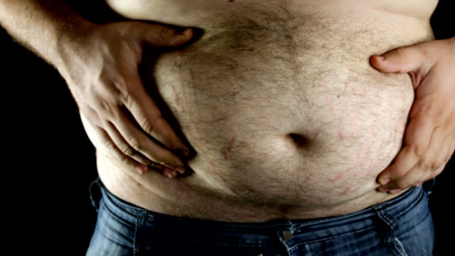 overweight man showing his belly - belly stock videos & royalty-free footage
