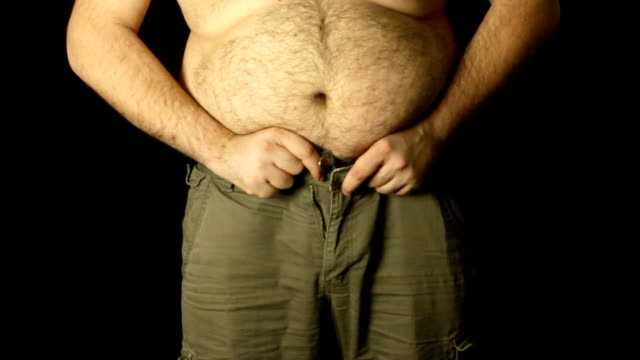 overweight man trying to get into jeans - stomach stock videos and b-roll footage