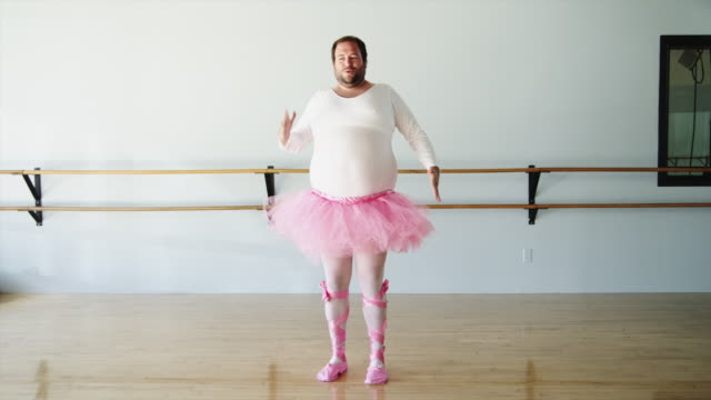 vídeos de stock e filmes b-roll de ws overweight man wearing ballerina costume practicing in ballet studio / orem,utah,usa - orem