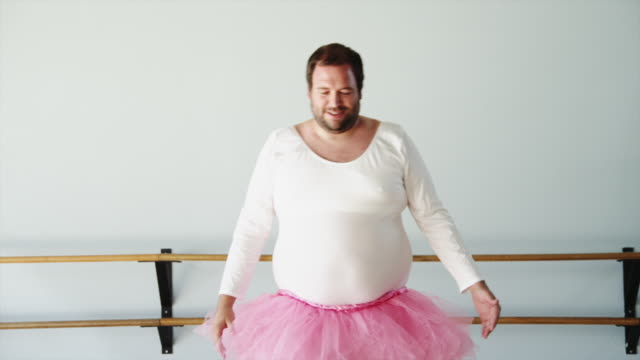 ms overweight man wearing ballerina costume practicing in ballet studio / orem,utah,usa - dance studio video stock e b–roll