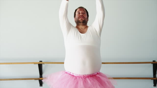 vídeos de stock e filmes b-roll de ms overweight man wearing ballerina costume practicing in ballet studio / orem,utah,usa - orem