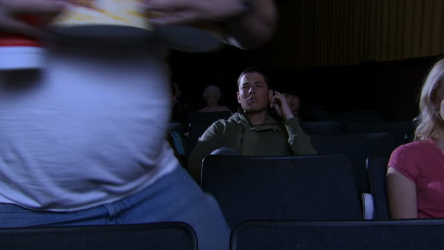 overweight man with popcorn at movie theatre with young couple - medium group of objects stock videos & royalty-free footage