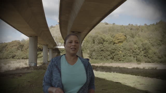 overweight mature black woman running cardio exercise under bridge in city, african american female jogging exercising outdoors, body positive plus size model - plus size model stock videos & royalty-free footage