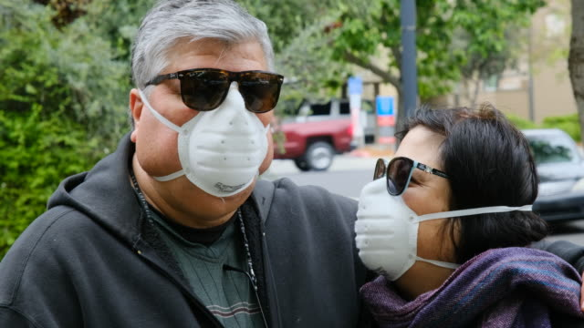overweight senior couple wearing a n95 protective mask due covid-19 pandemic - emergencies and disasters stock videos & royalty-free footage