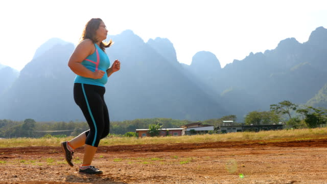 Overweight woman running at outdoor healthy lifestyle