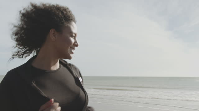 overweight young black woman running cardio exercise on beach, african american female at sunrise jogging exercising outdoors, body positive plus size model - plus size model stock videos & royalty-free footage