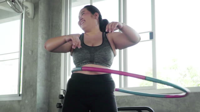 overweight young woman practicing hula hoop - overweight stock videos & royalty-free footage