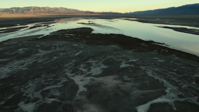 owens lake, a mostly dry salt lake, which was desiccated during the creation of the los angeles aqueduct in the early 20th century. - basin and range province stock videos and b-roll footage