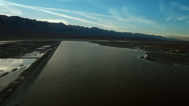 owens lake and the eastern sierra nevada mountains at dusk. - basin and range province stock videos and b-roll footage