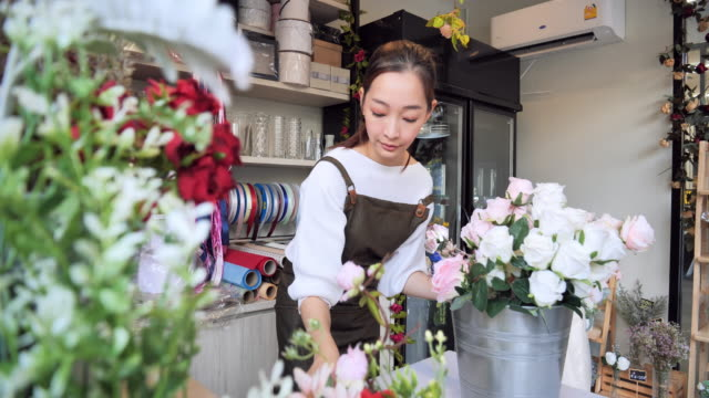 owned florist flower asian woman inside the shop to prepare for the sale, a japanese woman with professional florists, flower shops in the city, small business concept. - bouquet stock videos & royalty-free footage