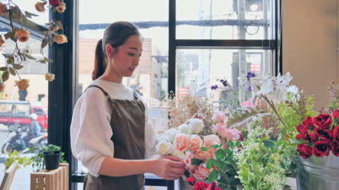 owned florist flower asian woman inside the shop to prepare for the sale, a japanese woman with professional florists, flower shops in the city, small business concept. - store stock videos & royalty-free footage