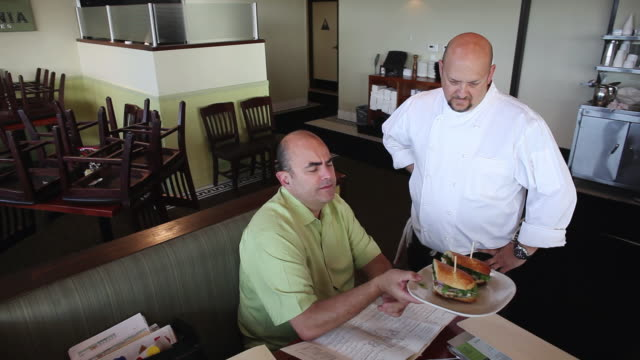ms owner and chef sharing ideas on burger / truxton's, california, usa - completely bald stock videos and b-roll footage