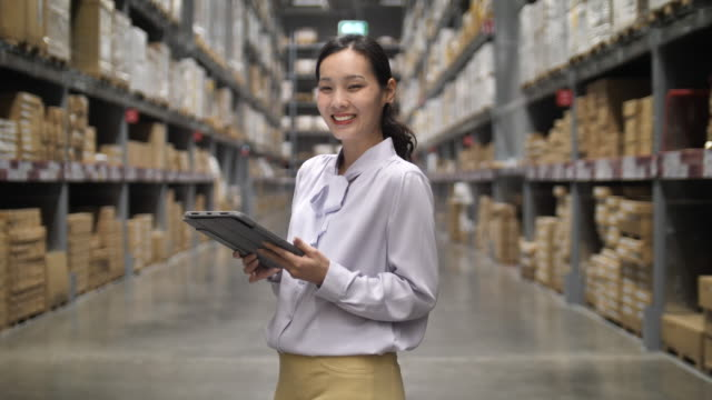 owner businesswoman with digital tablet in warehouse - e commerce stock videos & royalty-free footage