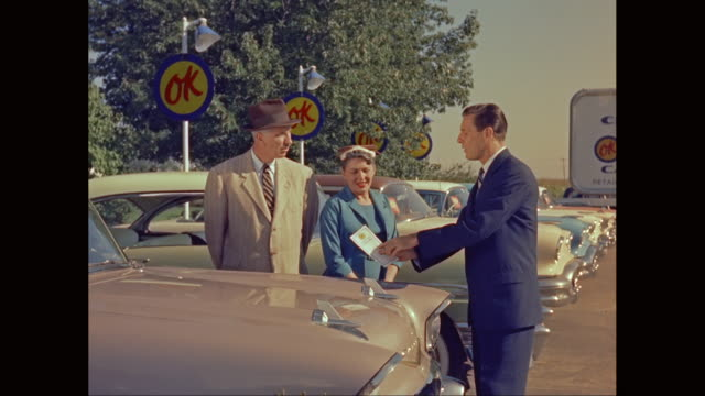 ws owner explaining to customers about buying a used car / united states - sale stock videos & royalty-free footage
