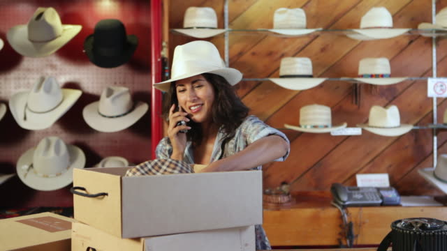cu owner of cowboy hat store talking on phone / santa fe, new mexico, united states - cowboy hat stock videos & royalty-free footage