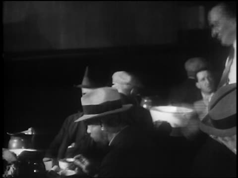 b/w 1929 owner of soup kitchen smiling talking to men eating / depression / newsreel - 1929 stock videos & royalty-free footage